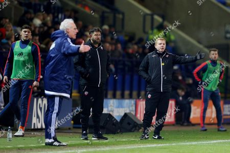 Bolton Wanderers manager Neil Lennon and Ipswich Town Manager, Mick McCarthy gesture to their players