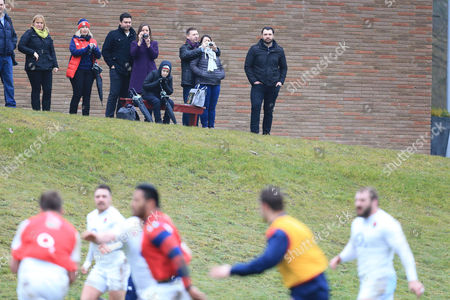Spectators, including former England prop Alex Corbisiero (right) watching training.