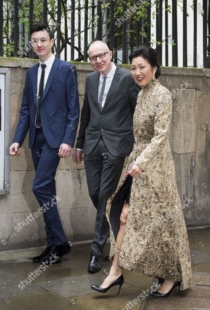 Robert Thomson, wife Wang Ping and son