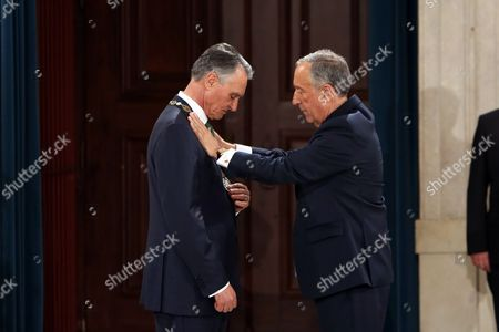 New President Marcelo Rebelo de Sousa awards the outgoing President Anibal Cavaco Silva with the Order of Liberty at the Ajuda Palace, after his swearing-in ceremony at the Portuguese Parliament in Lisbon