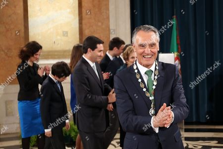 Outgoing President Anibal Cavaco Silva smiles after being awarded with the Order of Liberty at the Ajuda Palace