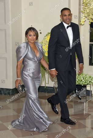 Grant Hill, Member of The President's Council on Fitness, Sports & Nutrition and wife Tamia Hill