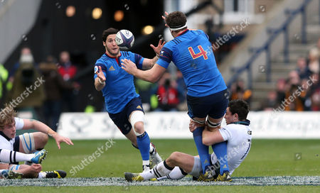 CAPTION CORRECTION Alexandre Flanquart (France)  passes to Maxime Machenaud as John Hardie of Scotland tackles