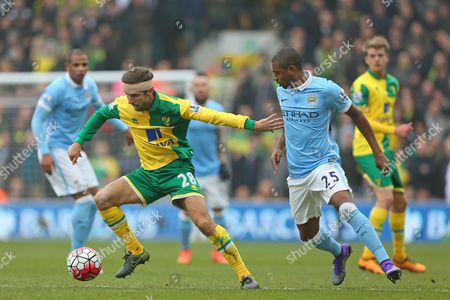 Gary O'Neil of Norwich City battles with Fernandinho of Manchester City - Norwich City v Manchester City, Barclays Premier League, Carrow Road, Norwich. 12 March 2016