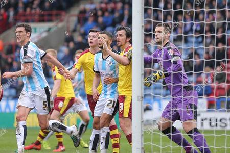 Burnley midfielder Joey Barton (13)  picks up Huddersfield Town forward Nahki Wells (21)  at the corner  during the Sky Bet Championship match between Huddersfield Town and Burnley at the John Smiths Stadium, Huddersfield