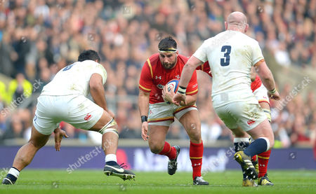 Scott Baldwin of Wales is tackled by Billy Vunipola of England.