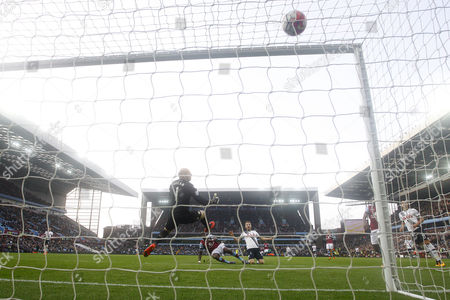 Harry Kane of Tottenham Hotspur scores a goal to make the score 0-2 past Aston Villa goalkeeper Brad Guzan during the Barclays Premier League match between Aston Villa and Tottenham Hotspur played at Villa Park, Birmingham on 13th March 2016