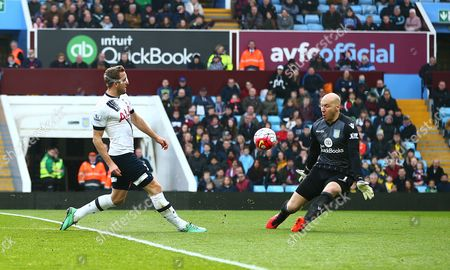 Harry Kane of Tottenham Hotspur beats Aston Villa goalkeeper Brad Guzan but his shot hits the crossbar during the Barclays Premier League match between Aston Villa and Tottenham Hotspur played at Villa Park, Birmingham on 13th March 2016