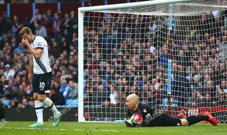 Harry Kane of Tottenham Hotspur shows a look of frustration as Aston Villa goalkeeper Brad Guzan holds the ball during the Barclays Premier League match between Aston Villa and Tottenham Hotspur played at Villa Park, Birmingham on 13th March 2016