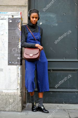 Model Karly Ashworth Loyce after Stella McCartney AW16, Paris Fashion Week 2016., on rue des Capucines.