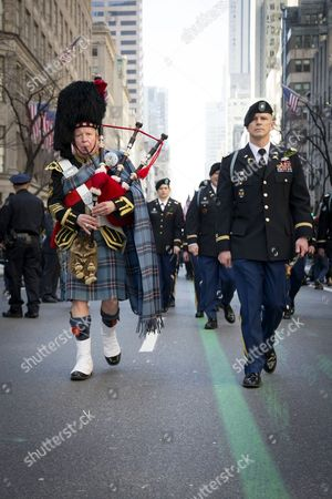 U.S. Army Lt. Col. Sean Flynn, commander of the 1st Battalion 69th Infantry, leads the parade in front of St Patricks Cathedral along the green line painted on 5th Ave during the parade on Saint Patricks Day in Manhattan.