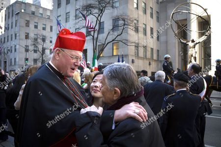 Timothy Cardinal Dolan Archbishop of New York greets Gabe Pressman the senior correspondent for WNBC TV in front of St Patricks Cathedral on Saint Patricks Day in Manhattan.