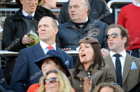 Stock Photo of Mike Tindall Watches His Horse Monbeg Dude With James Simpson-daniel In The Third Race At The Cheltenham Festival Cheltenham Gloucs.