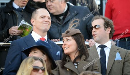 Stock Picture of Mike Tindall Watches His Horse Monbeg Dude With James Simpson-daniel In The Third Race At The Cheltenham Festival Cheltenham Gloucs. Cheltenham Festival 2015:.