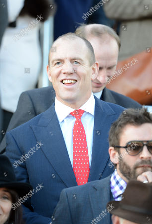 Editorial picture of Mike Tindall Watches His Horse Monbeg Dude With James Simpson-daniel In The Third Race At The Cheltenham Festival Cheltenham Gloucs.