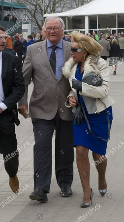 Ron Atkinson And His Wife Arrive At Cheltenham Festival On The St.patrick's Day Thursday Cheltenham Gloucs. Cheltenham Racing Festival 2015.