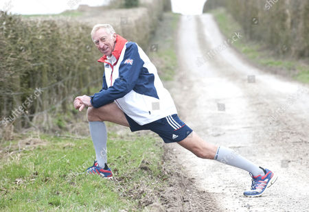 David Hemery Former Olympic Gold Medalist And Winner Of The Original Superstars In 1973 In Training For The London Marathon In Aid Of His Charity 21st Century Legacy. Picture Shows:- David Warming Up.