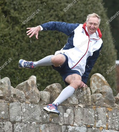 David Hemery Former Olympic Gold Medalist And Winner Of The Original Superstars In 1973 In Training For The London Marathon In Aid Of His Charity 21st Century Legacy. Picture Shows:- David Hurdling Stone Walls.