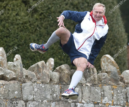 Editorial picture of David Hemery Former Olympic Gold Medalist And Winner Of The Original Superstars In 1973 In Training For The London Marathon In Aid Of His Charity 21st Century Legacy. Picture Shows:- David Hurdling Stone Walls.