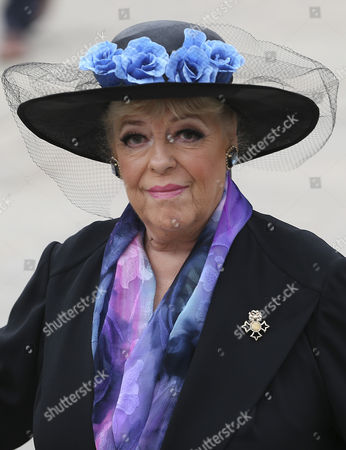 Julie Goodyear arrives at the service