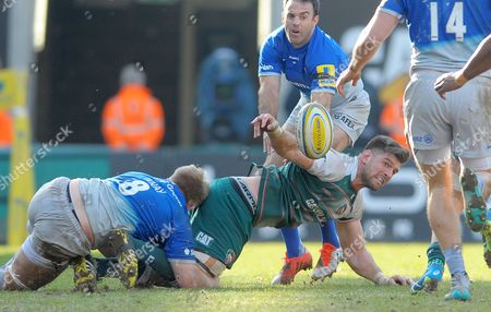 Leicester's Michael Fitzgerald tackled by Saracens' Jackson Wray (left) and surrounded flings out a speculative pass - Rugby Union - Aviva Premiership - 20/03/16 - Leicester Tigers v Saracens - at Welford Road Leicester UK. Photo Credit - Tom Dwyer/Seconds Left Images