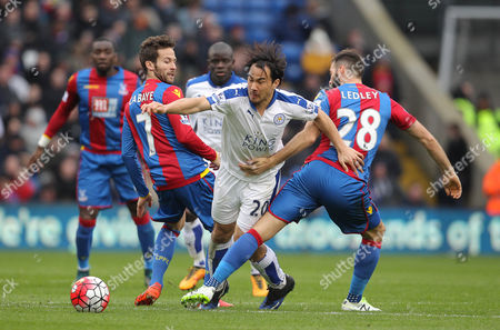 Shinji Okazaki of Leicester City is challenged by Yohan Cabaye ( L ) and Joe Ledley of Crystal Palace- Mandatory byline: Paul Terry/JMP