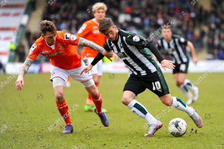 Luton Town's Glen Rea and Plymouth Argyle's Graham Carey during the Sky Bet League 2 match between Plymouth Argyle and Luton Town at Home Park, Plymouth