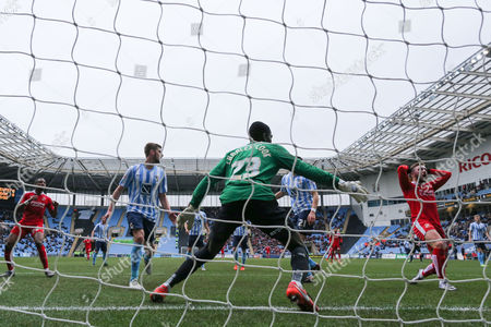 Swindon Town midfielder Anton Rodgers (26) can't believe he has missed during the Sky Bet League 1 match between Coventry City and Swindon Town at the Ricoh Arena, Coventry