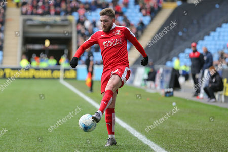 Swindon Town midfielder Anton Rodgers (26)  controls the ball during the Sky Bet League 1 match between Coventry City and Swindon Town at the Ricoh Arena, Coventry