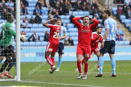 Swindon Town midfielder Anton Rodgers (26) can't believe he's missed the target during the Sky Bet League 1 match between Coventry City and Swindon Town at the Ricoh Arena, Coventry