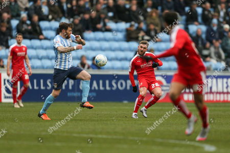 Swindon Town midfielder Anton Rodgers (26)  plays the ball through during the Sky Bet League 1 match between Coventry City and Swindon Town at the Ricoh Arena, Coventry