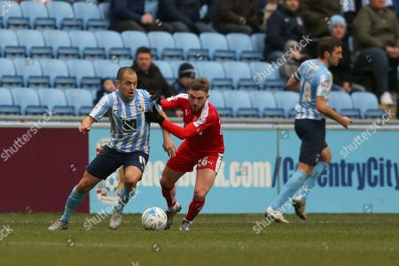 Swindon Town midfielder Anton Rodgers (26)  gets a hold of Coventry City midfielder Joe Cole (14) and gets a yellow card for his troubles during the Sky Bet League 1 match between Coventry City and Swindon Town at the Ricoh Arena, Coventry