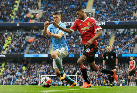 Marcus Rashford of Manchester United and Martin Demichelis of Manchester City during the Barclays Premier League match between Manchester City and Manchester United played at the Etihad Stadium, Manchester on March 20th 2016