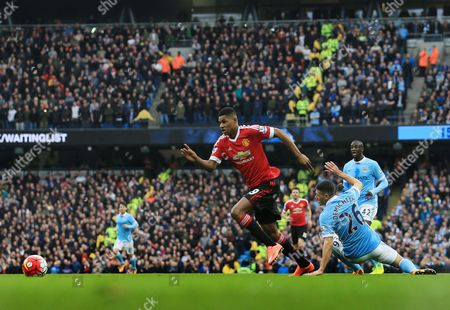 Marcus Rashford of Manchester United gets away from Martin Demichelis of Manchester City to score the opening goal of the game during the Barclays Premier League match between Manchester City and Manchester United played at the Etihad Stadium, Manchester on March 20th 2016