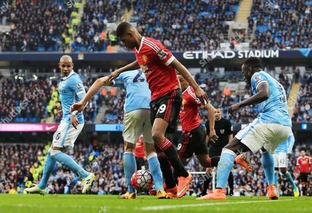 Marcus Rashford of Manchester United puts the ball through the legs of Martin Demichelis of Manchester City during the Barclays Premier League match between Manchester City and Manchester United played at the Etihad Stadium, Manchester on March 20th 2016