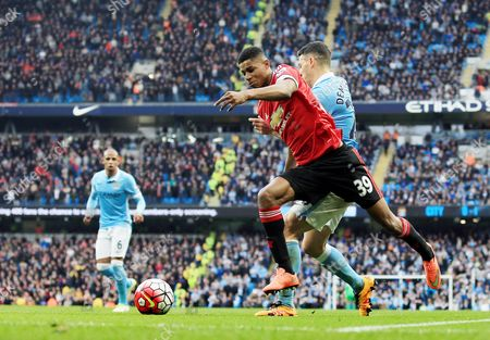 Marcus Rashford of Manchester United goes over from a challenge by Martin Demichelis of Manchester City but no penalty kick was awarded during the Barclays Premier League match between Manchester City and Manchester United played at the Etihad Stadium, Manchester on March 20th 2016