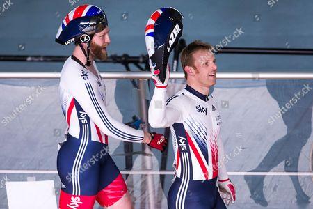 Great Britain's Jon-Allan Butterworth (L) and Jody Cundy (R) celebrate winning Gold (alongside Louis Rolfe) in the Team Sprint Finals.