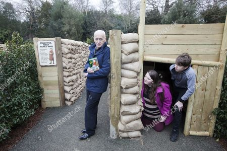 Stock Picture of Terry Deary, author of Horrible Histories series, with visitors Finlay Dockerty (16) and Logan Dockerty (13)  in the Frightful 1st World War zone of the maze