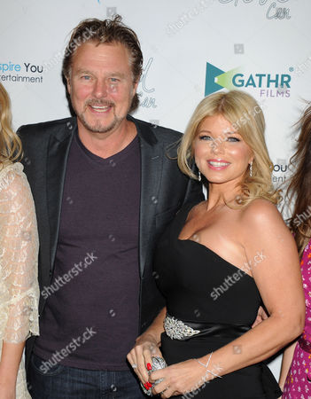 Stock Picture of Greg Evigan and Donna D'Errico