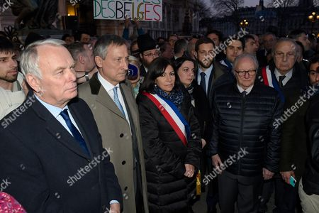 Jean-Marc Ayrault, the Belgian Ambassador to France Vincent Mertens de Wilmars, Anne Hidalgo, Roger Cukierman and Pierre Aidenbaum pay tribute to victims of terrorist attacks in Brussels at Paris City Hall