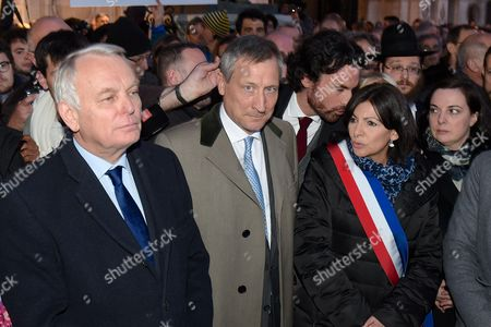Stock Image of Jean-Marc Ayrault, the Belgian Ambassador to France Vincent Mertens de Wilmars, Anne Hidalgo, Roger Cukierman and Pierre Aidenbaum pay tribute to victims of terrorist attacks in Brussels at Paris City Hall