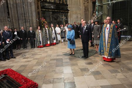 Queen Elizabeth II, Prince Philip together with Prince William, Catherine Duchess of Cambridge, Prince Harry and Prince Andrew and The The Very Reverend John Hall at the start of the service.
