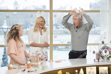 Sophie Prescott, Holly Willoughby and Phillip Schofield who are wearing Easter bunny ears made of sanitary towels
