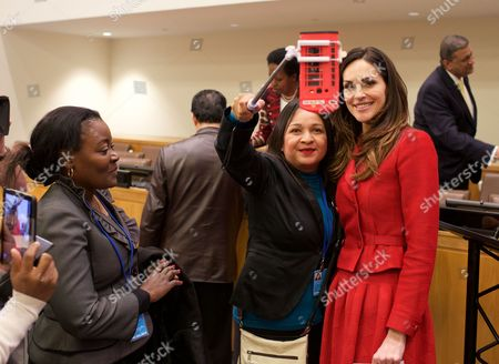 Tasha De Vasconcelos takes a selfie with a fan