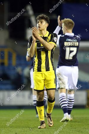 Tyler Walker, son of Des Walker, currently playing for Burton on loan from Nottingham Forest applauds the away fans at the end of the match during Millwall vs Burton Albion, Sky Bet League 1 Football at The Den on 28th March 2016