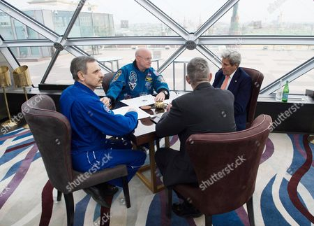 U.S. Secretary of State John Kerry speaks with Astronaut Scott Kelly and Cosmonaut Mikhail Kornienko, who have been back on Earth for about three weeks since completing one year in space aboard the International Space Station