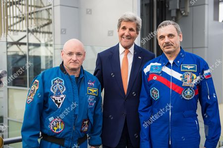 U.S. Secretary of State, John Kerry, center, poses for a photo with NASA astronaut Scott Kelly, left, and Russian cosmonaut Mikhail Kornienko of Roscosmos, right, at a meeting to discuss their year aboard the International Space Station