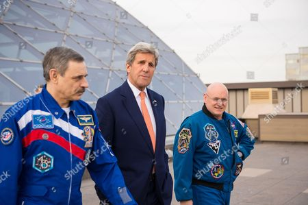 U.S. Secretary of State, John Kerry, center, meets with Russian cosmonaut Mikhail Kornienko of Roscosmos, left, and NASA astronaut Scott Kelly, right to discuss their year aboard the International Space Station