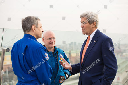 Stock Picture of U.S. Secretary of State, John Kerry, right, meets with NASA astronaut Scott Kelly, center, and Russian cosmonaut Mikhail Kornienko of Roscosmos, left, to discuss their year aboard the International Space Station
