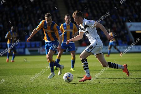 Sam Kelly of Port Vale FC sprints clear of Shaun Whalley of Shrewsbury Town during the Sky Bet League 1 match between Shrewsbury Town and Port Vale at Greenhous Meadow, Shrewsbury